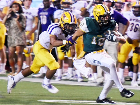 Captain Shreve's Stephen Smith tries to get past Byrd's defense Thursday evening at Lee Hedges Stadium.