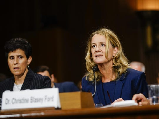 Christine Blasey Ford, with lawyer Debra S. Katz, left, answers questions at a Senate Judiciary Committee hearing on Thursday, September 27, 2018 on Capitol Hill.
