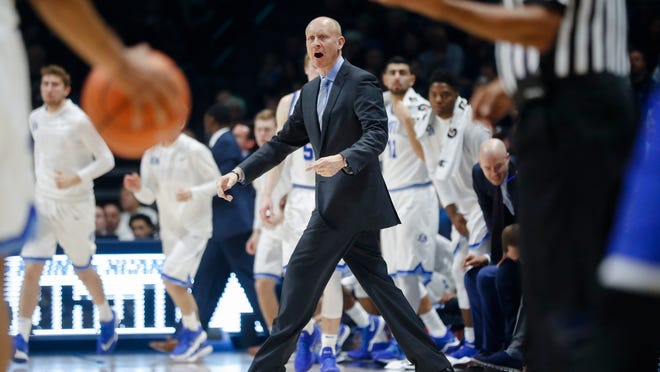 Xavier head coach Chris Mack reacts during a timeout in the first half of an NCAA college basketball game against Creighton, Saturday, Jan. 13, 2018, in Cincinnati. (AP Photo/John Minchillo)