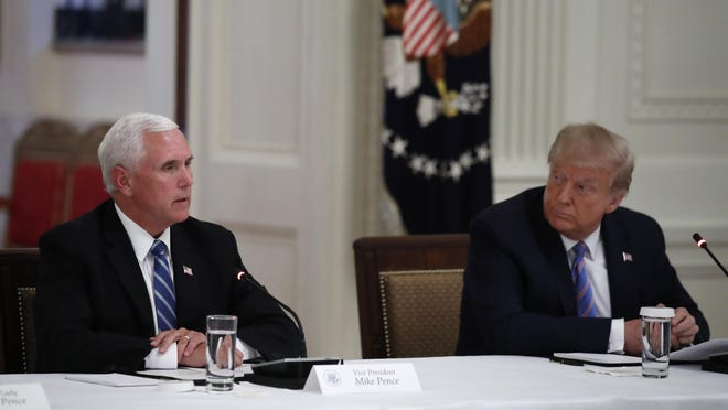 "President Donald Trump listens as Vice President Mike Pence speaks during a ""National Dialogue on Safely Reopening America's Schools,"" event in the East Room of the White House, Tuesday, July 7, 2020, in Washington."