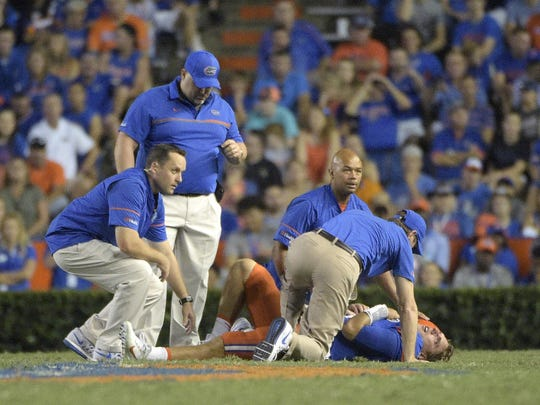 Florida quarterback Luke Del Rio (14) is helped by trainers after injuring his leg during the second half of an NCAA college football game against North Texas in Gainesville, Fla., Saturday, Sept. 17, 2016. (AP Photo/Phelan M. Ebenhack)