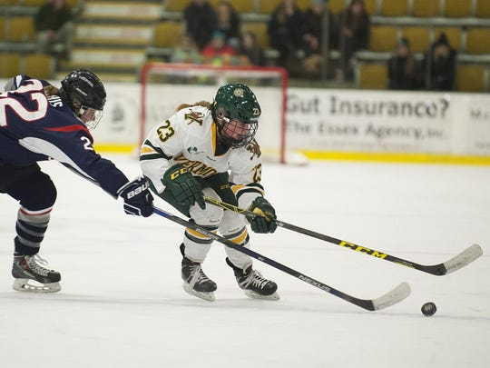 Vermont's Alyssa Gorecki (23) skates past UConn's Kelly Harris (22) with the puck during the women's hockey game between the UConn Huskies and the Vermont Catamounts at Gutterson Field House on Friday night January 29, 2016 in Burlington.