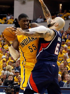 Pacers center Roy Hibbert, left, struggled with Hawks center Pero Antic in Game 1 of their first-round series.