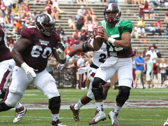 Mississippi State quarterback Dak Prescott, right, will attend the Manning Passing Academy this summer as a counselor, making his the second straight Bulldog QB to do so.