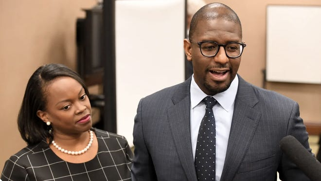 Former Tallahassee Mayor Andrew Gillum and his wife, R. Jai Gillum, answer questions after it was announced that he settled in his case with the Florida Commission on Ethics in 2019.