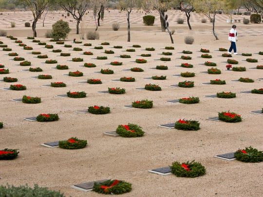 Wreaths are displayed on the gravestones of veterans buried at the National Memorial Cemetery of Arizona in north Phoenix  in December 2009.