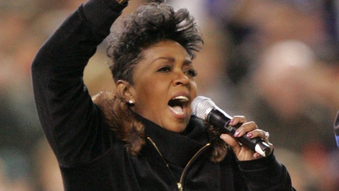 Anita Baker sings prior to the start of Game 2 of the World Series between the Detroit Tigers and the St. Louis Cardinals at Comerica Park in Detroit on Oct. 22, 2006.