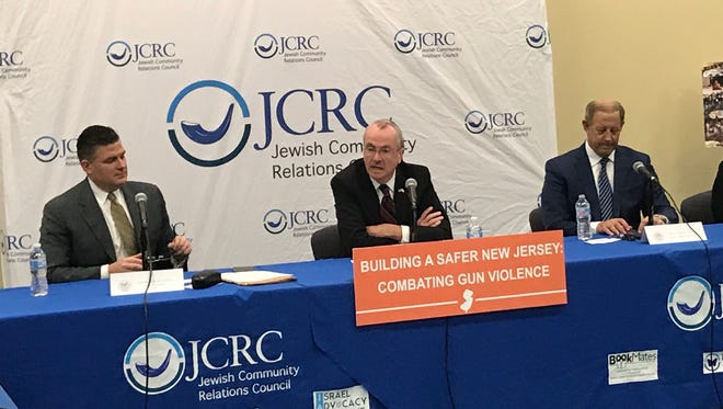 Gov. Phil Murphy speaks during a discussion on gun violence prevention strategies at the Betty and Milton Katz Jewish Community Center in Cherry Hill on Feb. 13, 2018. He is seated between Assembly Majority Leader Lou Greenwald, D-Camden, left, and Cherry Hill Mayor Chuck Cahn.