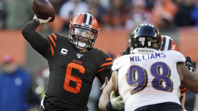 Browns QB Baker Mayfield (6) loads up a pass while Baltimore's Brandon Williams (98) tries to beat a block during a game in Cleveland last Dec. 22.