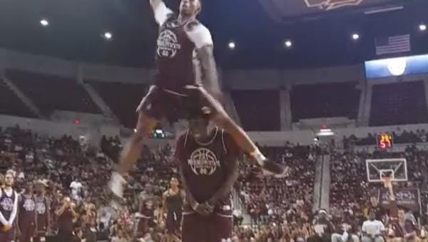 Mississippi State senior Craig Sword leaped over Fallou Ndoye on Friday night to win the dunk contest.