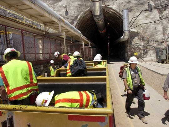 Workers at Yucca Mountain, site of the proposed national nuclear waste dump near Mercury, Nev., get off a train that takes them in and out of the mountain in this file photo taken June 25, 2002. Nevada is again denying water rights to the Yucca Mountain site.