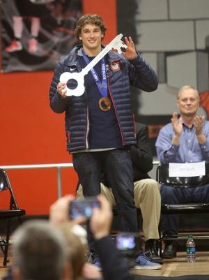 Olympian Nick Goepper holds up a key to the city he received at a reception on his behalf at Lawrenceburg High School in Lawrenceburg, Indiana, on Saturday, March 8, 2014.