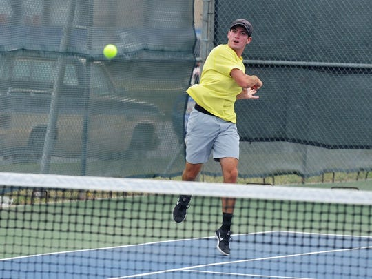 Wylie's Lane Adkins follows through during the quarterfinals of the Abilene Eagle Invitational at Cooper on Friday, March 23, 2018. Adkins defeated Aledo's Jared Klem 6-0, 6-0 to reach Saturday's A boys singles semifinal.