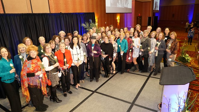 During the 10th Annual WomenGive Lunch on Feb. 25, 2015, in Loveland, 75 Charter Members were honored as the nonprofit's Philanthropist of the Decade.