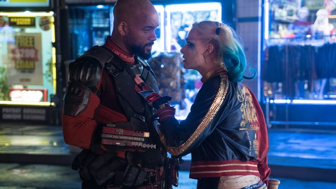 Deadshot (Will Smith) and Harley Quinn (Margot Robbie) discuss the mission in 'Suicide Squad.'