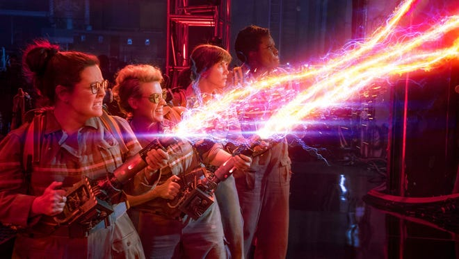 "Abby (Melissa McCarthy), Holtzmann (Kate McKinnon), Erin (Kristen Wiig) and Patty (Leslie Jones) take on a ghost in ""Ghostbusters."""