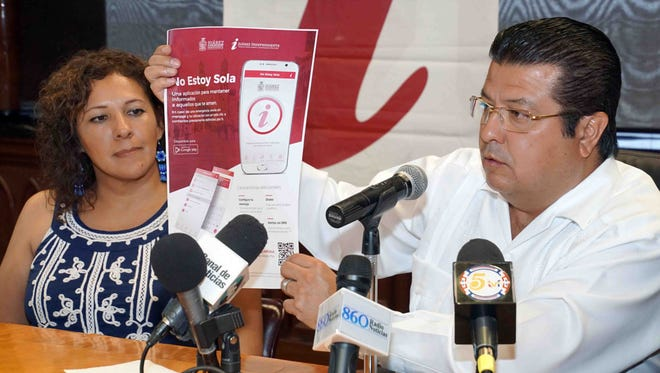 "Juárez Mayor Armando Cabada holds a news conference Wednesday to launch the new app ""No Estoy Sola,"" which is designed to assist women in danger. At left is Veronica Corchado, director of the municipal institute for women in Juárez."