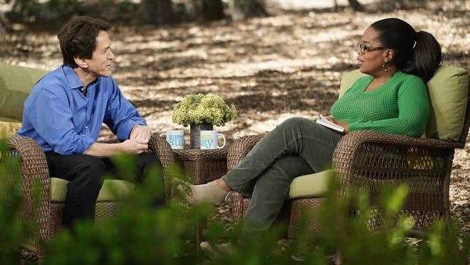 "Mitch Albom talks with Oprah Winfrey on the set of her show, ""SuperSoul Sunday"" on OWN. The episode featuring Albom, a Detroit Free Press columnist, will air at 11 a.m. Sunday, Aug. 27."