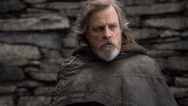 "This image released by Lucasfilm shows Mark Hamill as Luke Skywalker in ""Star Wars: The Last Jedi,"" in theaters Dec. 15."