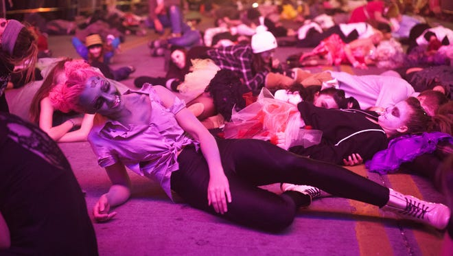 """Dancers perform """"Thriller"""" at the 2014 Reno Zombie Crawl."""