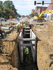 Garney Construction workers prepare a 10-foot trench