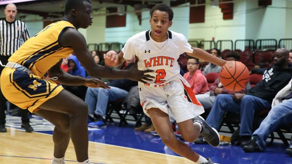 White Plains' Eisaiah Murphy (2) drives on Mount St. Michael's Ibrahim Wattara (11) during the Slam Dunk Basketball Tournament consolation game at The Westchester County Center in White Plains on Friday, December 29, 2017.