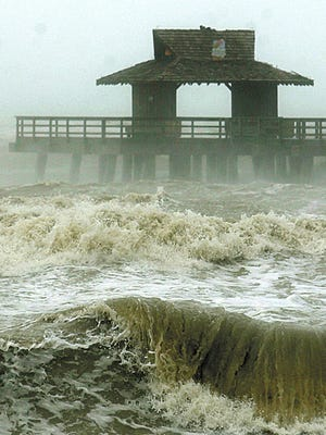 Angry seas rage as the Naples Pier is battered by wind and rains blowing in from the north on the backside of Hurricane Wilma in October 2005. Wilma blew into Collier County as a Category 3 storm.