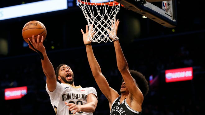 Anthony Davis goes to the basket against Nets center Jarrett Allen.