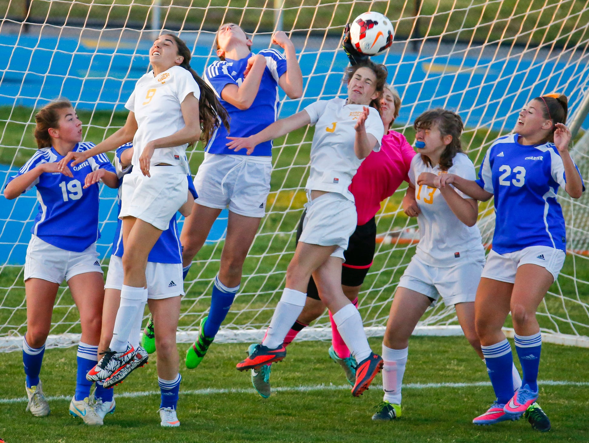 Caesar Rodney's Jessie Prillaman (9), Aleya Cummings (center) and Megan Powers (13) move for a corner kick against Charter in the second half of the Riders' 2-1 win at Caesar Rodney High School Friday. Cummings provided both goals for the Riders.