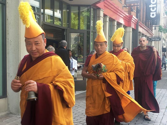 Drepung Gomang monks begin the Peace Walk to the Ohio River outside Actors Theatre at the conclusion of the Festival of Faiths.