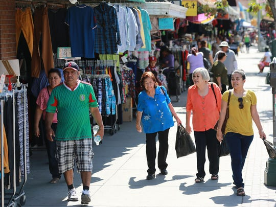 Shoppers in El Centro shopping district on South El Paso Street. This is one of the areas highlighted in the new, Downtown Authentico marketing campaign.