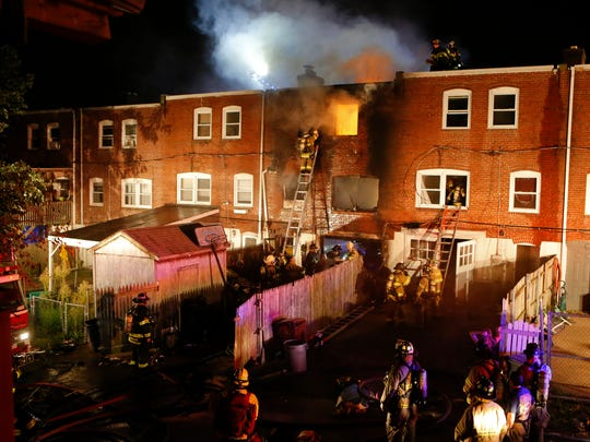 Flames fill a Canby Park rowhouse on Saturday, when two Wilmington firefighters were killed. Lt. Christopher Leach, 41, was 14-year veteran and Senior Firefighter Jerry Fickes, 51 was a 13-year veteran.