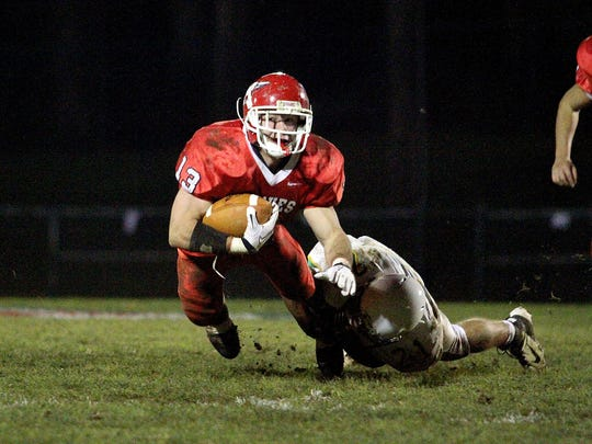 11-18-11 Manalapan High School. West Windsor-Plainsboro South at Manalapan for the NJSIAA Central IV semifinal football playoff . Manalapan's J Sieczkowski gets hit by WWPS's Brian Schoenauer. Photo by Keith J. Woods/special to the press