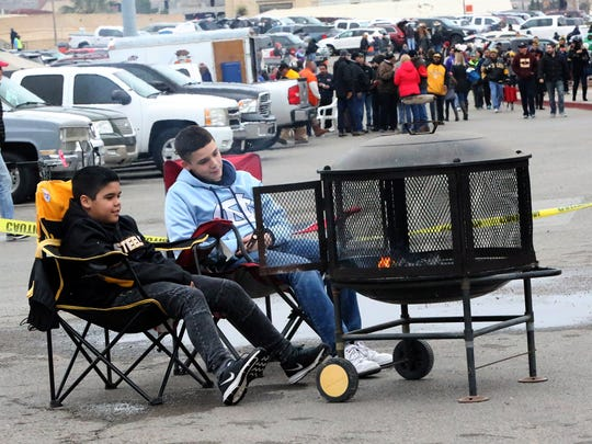 Roman Ponce, 10, left and big brother Aaron Ponce,