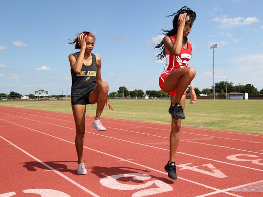 Rider's A'Zhariah Veasy (left) and Hirschi's Azan Sargusingh (right) didn't originally run the 400, but their hard work in the event have earned them trips to state.