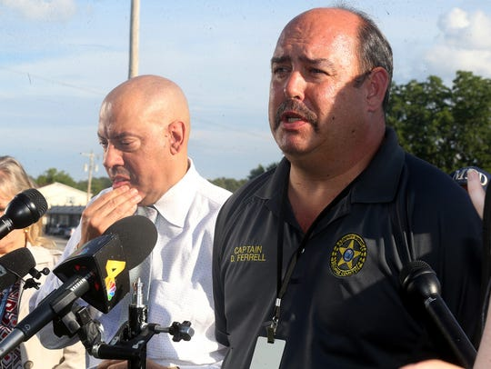 Coffee County Sheriff's Capt. Danny Ferrell, right,