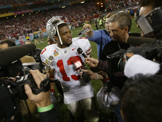 Ohio State star Maurice Clarett speaks with reports