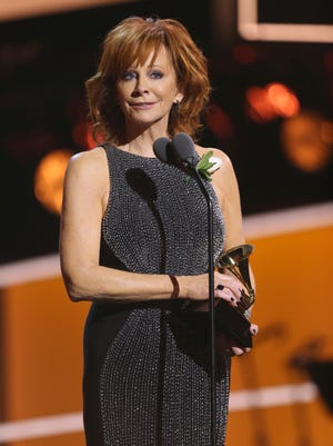 """Reba McEntire accepts the award for best roots gospel album for """"Sing It Now: Songs of Faith & Hope"""" at the 60th annual Grammy Awards at Madison Square Garden on Sunday, Jan. 28, 2018, in New York."""