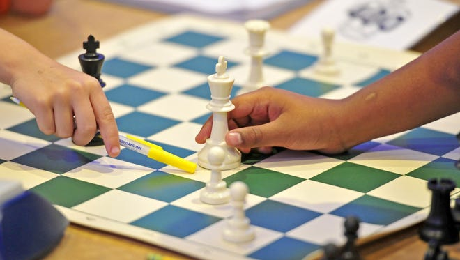 Kids play chess during the National Elementary (K-6) Championship at Gaylord Opryland Resort & Convention Center in Nashville on May 8, 2015.