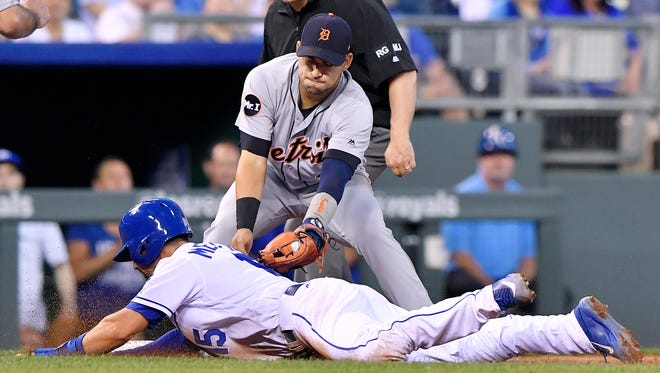 Detroit Tigers shortstop Jose Iglesias tags out the Kansas City Royals' Whit Merrifield to end the fifth inning in a rundown on a grounder by Alex Gordon at Kauffman Stadium.