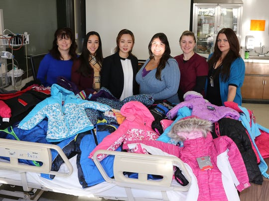 "The program, called ""Coats for Kids"" is an annual event to aid patients at Raritan Bay. Left to right:  Patricia Fox of East Brunswick, nursing instructor and association advisor; Elisabeth Martinez of South Brunswick, treasurer; So Chung of Edison, vice president; Nichole O'Donnell of Woodbridge, secretary; Tara Renter of Old Bridge, president; and Luiza Asahme of Woodbridge, instructor and association advisor."