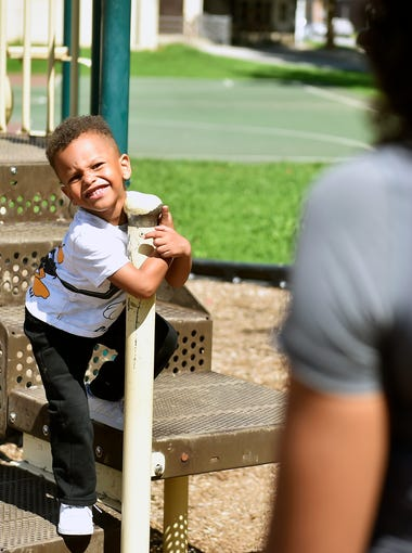 """Jordan Breeland Jr., 3, plays in York's Albemarle Park under the eye of mother Kenyetta Redman, right, Wednesday, Aug. 23, 2017, between school and a dentist appointment. In Oct. 2013, Kenyetta Redman was five months pregnant when Jordan Breeland, her boyfriend and the father of her child, was shot and killed via an illegally possessed gun. Jordan Breeland Jr., born in Feb. 2014, has never known his father, whom he and Redman refer to as """"Big Jordan."""""""