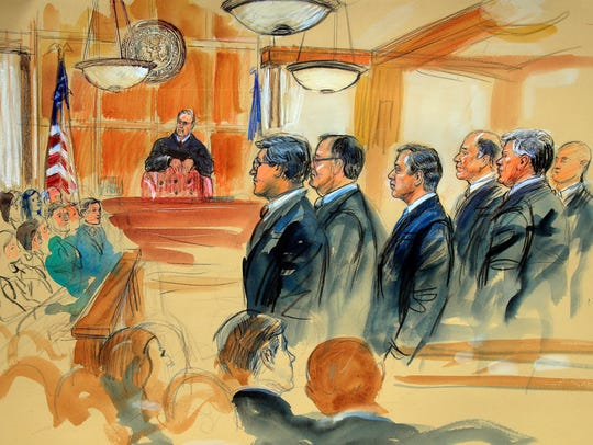 This courtroom sketch depicts Paul Manafort, fourth from right, standing with his lawyers in front of U.S. District Judge T.S. Ellis III and the selected jury, seated left, during his trial in Alexandria, Va.