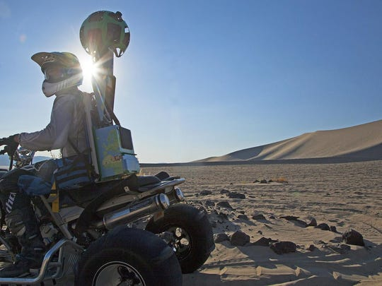 A quad rider uses a Google Trekker pack to shoot images of Nevada's Sand Mountain Recreation Area near Fallon.