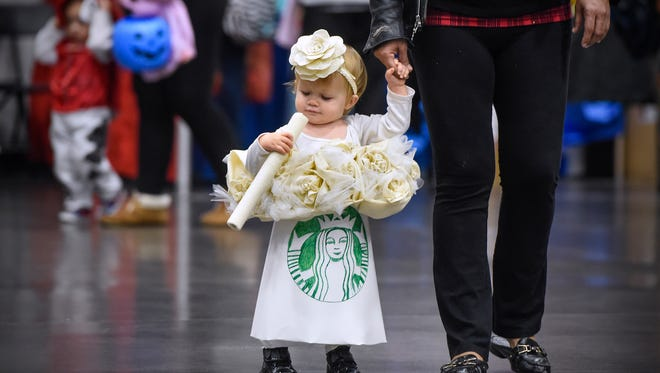 Olivia Pederson is dressed as a Starbucks coffee cup during the Kids & Parents Expo Saturday, Oct. 29, at the River's Edge Convention Center in St. Cloud.