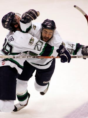 Florida Everblades teammates Adam Taylor, left, and Chris Lee celebrate after Lee made the game-winning goal in overtime against the Texas Wildcatters in 2007.