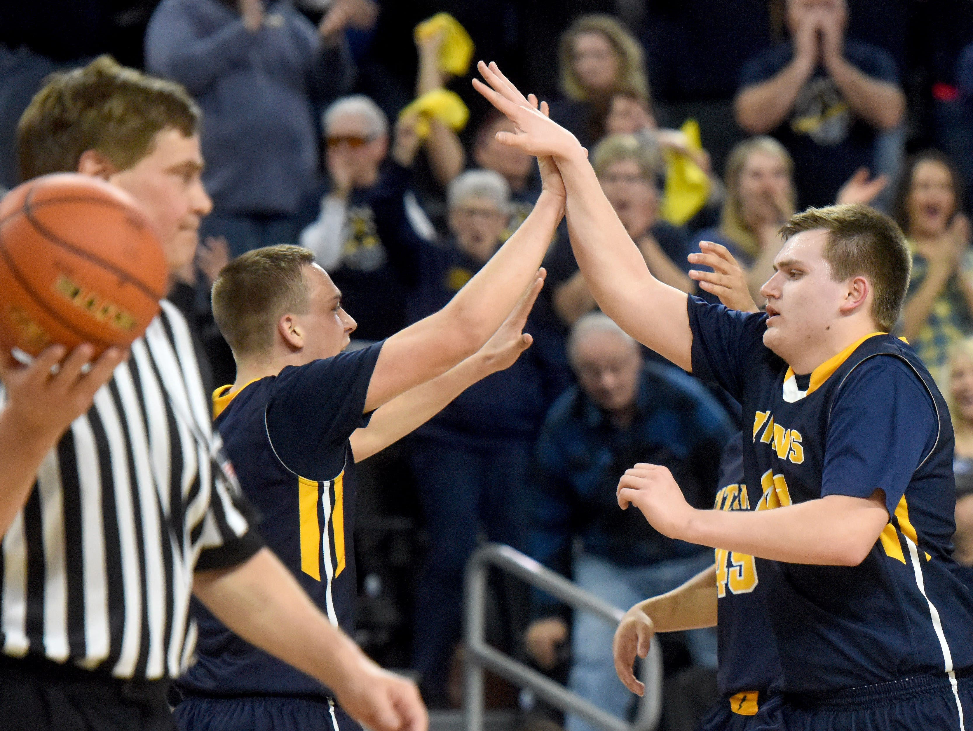 Tea Area's Noah Freidel high fives teammate Kaleb Joffer at half time against Madison during the 2017 SDHSAA Class A boy's basketball championship at the Denny Sanford Premier Center on Saturday, March 18, 2017.