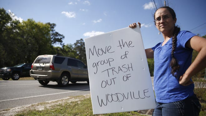 """Christina Wortham protests on the roadside of Woodville Highway out of concern for the almost a dozen sexual offenders who are being housed less than 1,500 feet from Woodville Elementary school, where her child is enrolled. """"There are sex offenders everywhere you go, but not usually under one roof,"""" said Wortham. """"and they are the minimal legal distance away from the school."""""""
