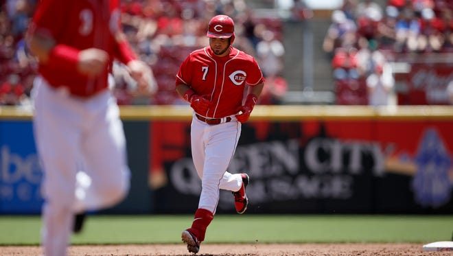 Cincinnati Reds third baseman Eugenio Suarez (7) rounds the bases behind second baseman Scooter Gennett (3) after hitting a grand slam in the bottom of the third inning of the MLB National League game between the Cincinnati Reds and the Pittsburgh Pirates at Great American Ball Park in downtown Cincinnati on Thursday, May 24, 2018.