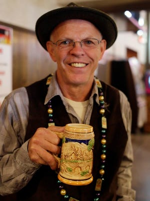 Larry Ladwig of Howards Grove holds a stein of beer during Oktoberfest at Al and Al's Steinhaus Saturday October 3, 2015 in Sheboygan.